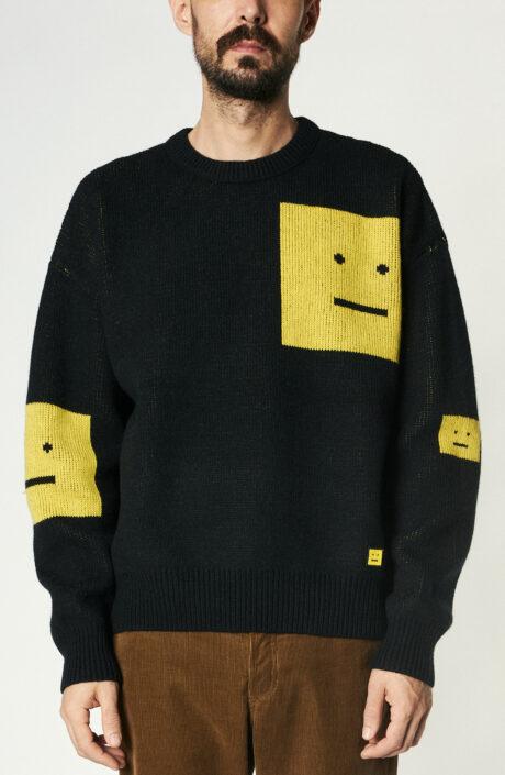 Schwarzer Pullover aus Wolle mit gelbem Face-Design